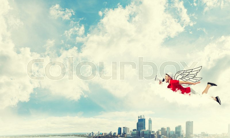 Stock image of 'Young cheerful man flying high above city and playing fife'