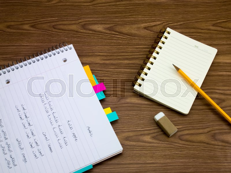 Stock image of 'Arabic; Learning New Language Writing Words on the Notebook'