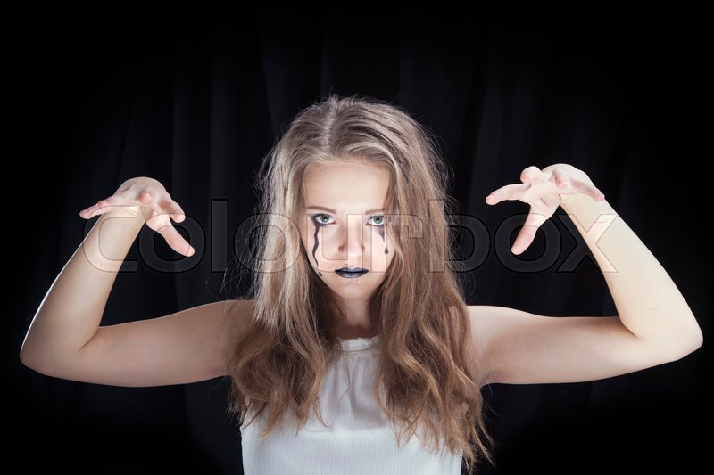 Stock image of 'Make-up for the celebration of Halloween, the girl in a white dress on a black background'