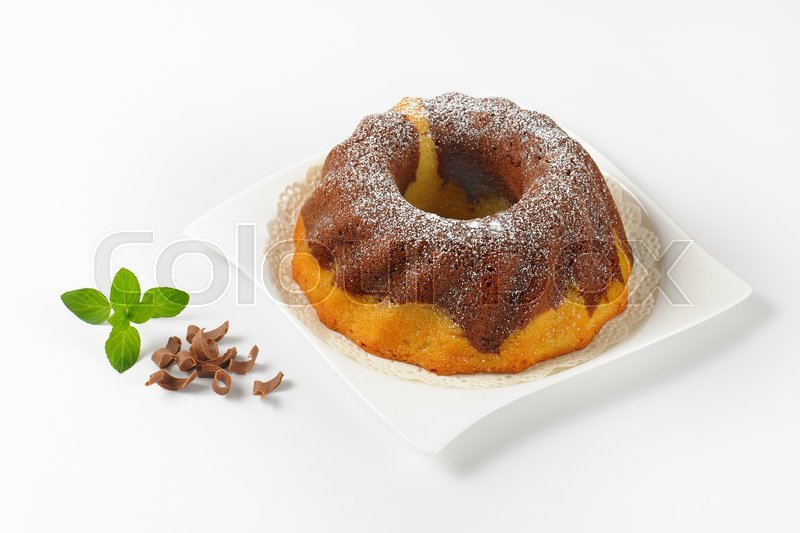 Stock image of 'marble bundt cake on white square plate'