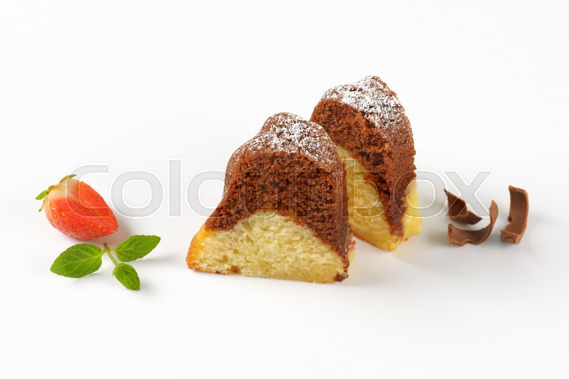 Stock image of 'two slices of marble bundt cake on white background'
