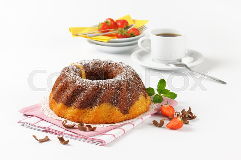 Stock image of 'marble bundt cake and cup of coffee'