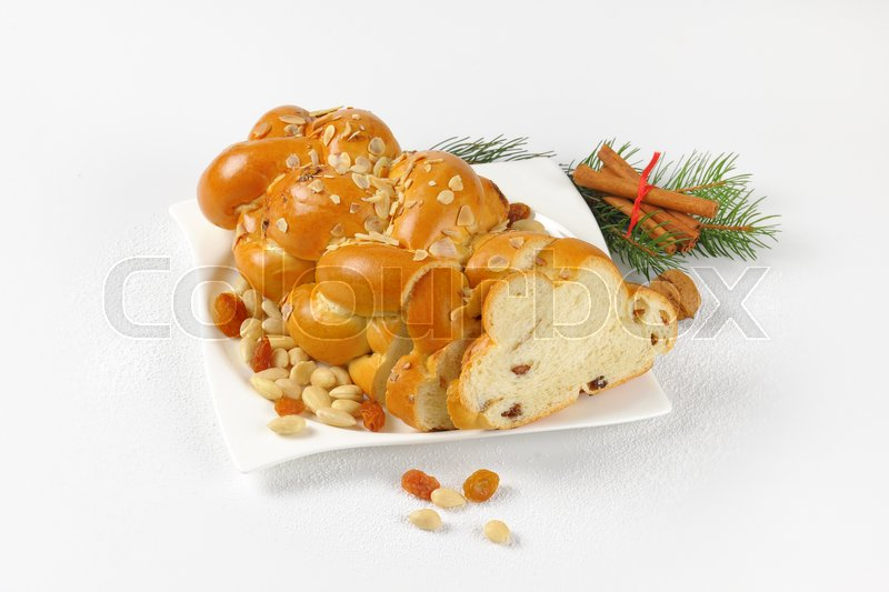 Stock image of 'Christmas sweet braided bread with almonds and raisins'