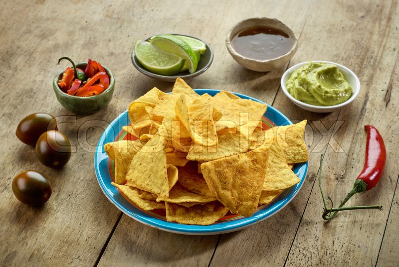 Stock image of 'Mexican food Nachos chips on wooden table'