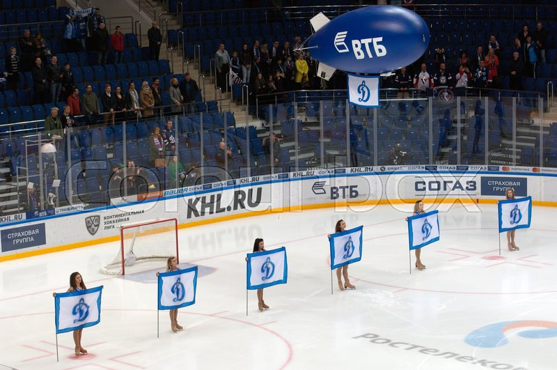 Editorial image of 'MOSCOW, RUSSIA - OCTOBER 12, 2016: Unidentified cheerleaders with banner just before  hockey game Dynamo Moscow vs Slovan Bratislava on Russia KHL championship. Slovan won 5:3'