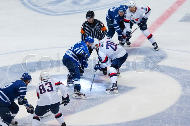 Editorial image of 'MOSCOW, RUSSIA - OCTOBER 12, 2016: A. Tsvetkov (9) vs J. Taffe (20) on faceoff hockey game Dynamo Moscow vs Slovan Bratislava on Russia KHL championship. Slovan won 5:3'