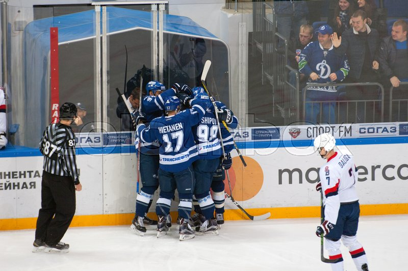 Editorial image of 'MOSCOW, RUSSIA - OCTOBER 12, 2016: Unidentified players of Dynamo rejoice of score on hockey game Dynamo Moscow vs Slovan Bratislava on Russia KHL championship. Slovan won 5:3'