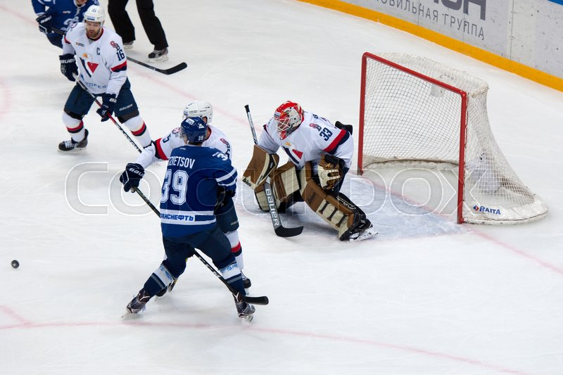 Editorial image of 'MOSCOW, RUSSIA - OCTOBER 12, 2016: A. Kuznetsov (39) attack on hockey game Dynamo Moscow vs Slovan Bratislava on Russia KHL championship. Slovan won 5:3'