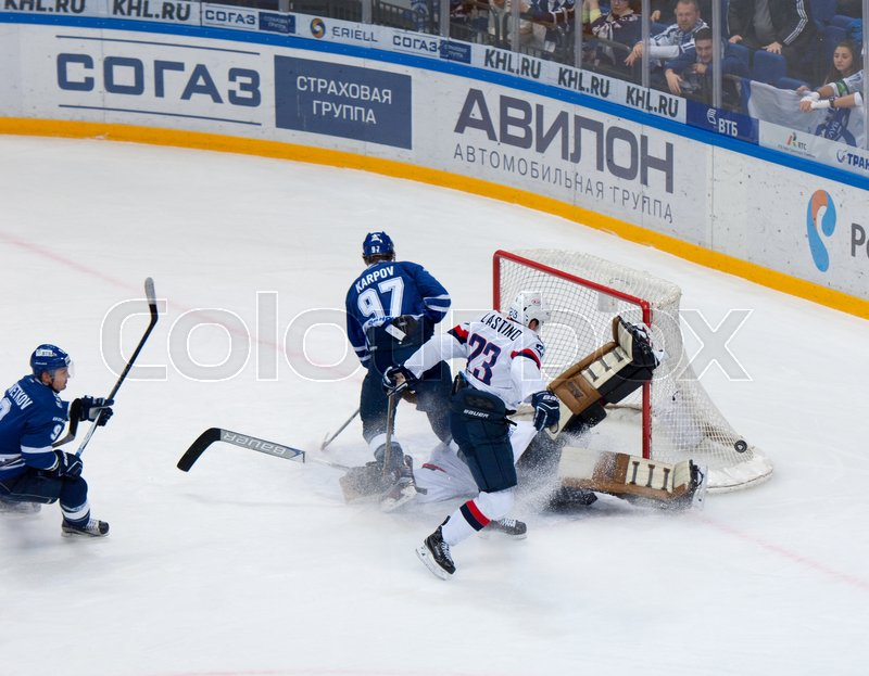 Editorial image of 'MOSCOW, RUSSIA - OCTOBER 12, 2016: Barry Brust (33) save the gate on hockey game Dynamo Moscow vs Slovan Bratislava on Russia KHL championship. Slovan won 5:3'