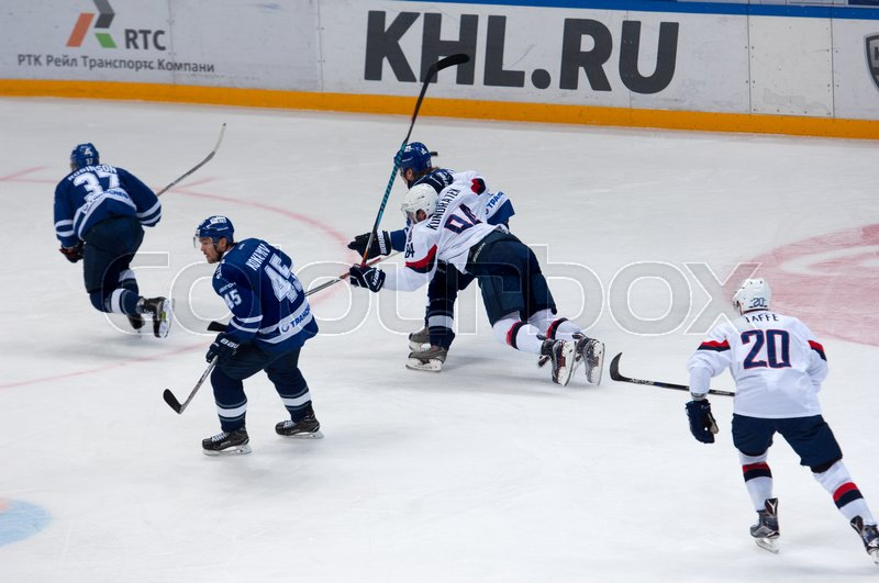 Editorial image of 'MOSCOW, RUSSIA - OCTOBER 12, 2016: T. Kundratek (84) fall down on hockey game Dynamo Moscow vs Slovan Bratislava on Russia KHL championship. Slovan won 5:3'