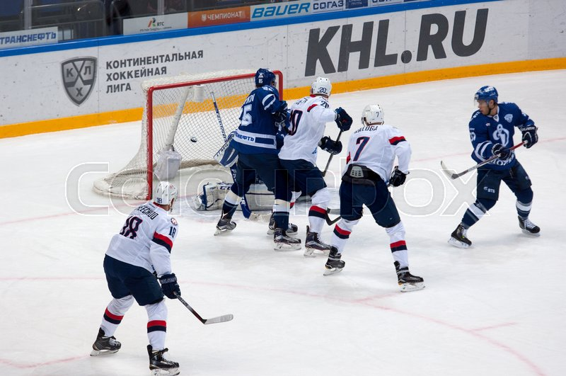 Editorial image of 'MOSCOW, RUSSIA - OCTOBER 12, 2016: J. Taffe (20) score on hockey game Dynamo Moscow vs Slovan Bratislava on Russia KHL championship. Slovan won 5:3'