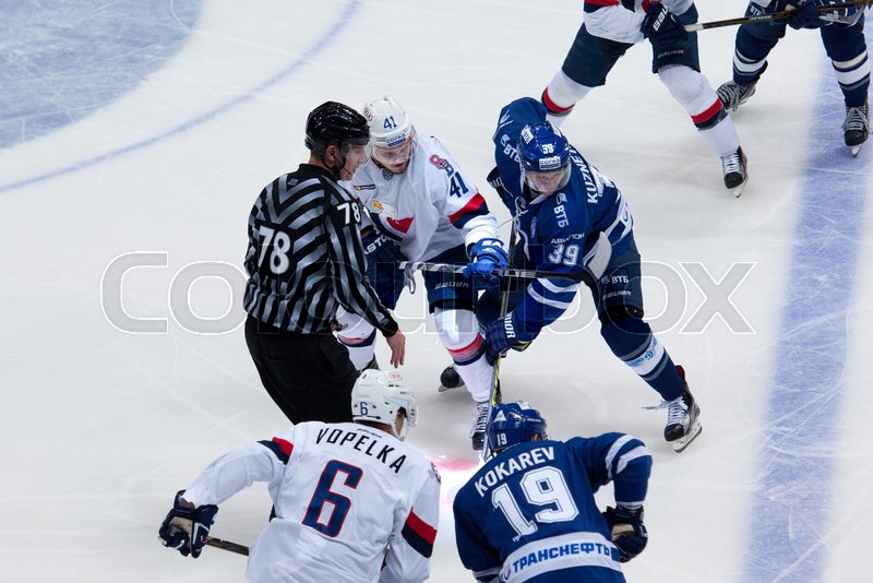 Editorial image of 'MOSCOW, RUSSIA - OCTOBER 12, 2016: A. Kuznetsov (39) and P. Lusnak (41) on faceoff on hockey game Dynamo Moscow vs Slovan Bratislava on Russia KHL championship. Slovan won 5:3'