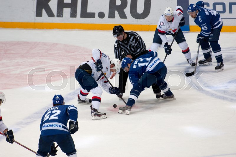 Editorial image of 'MOSCOW, RUSSIA - OCTOBER 12, 2016: V. Nedorost (13) and A. Rybakov (12) on faceoff on hockey game Dynamo Moscow vs Slovan Bratislava on Russia KHL championship. Slovan won 5:3'