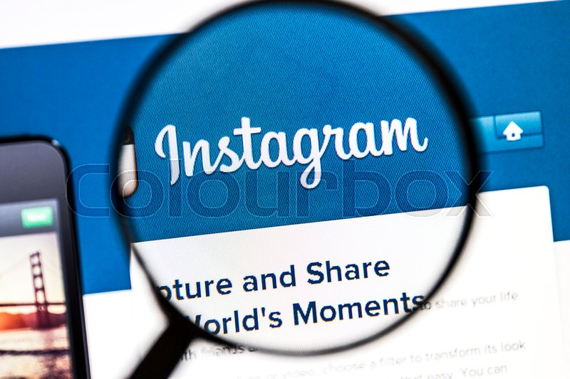 Editorial image of 'Ostersund, Sweden - August 3, 2014: Close up of instagram website under a magnifying glass.Instagram is an online mobile photo-sharing, video-sharing and social networking service.'