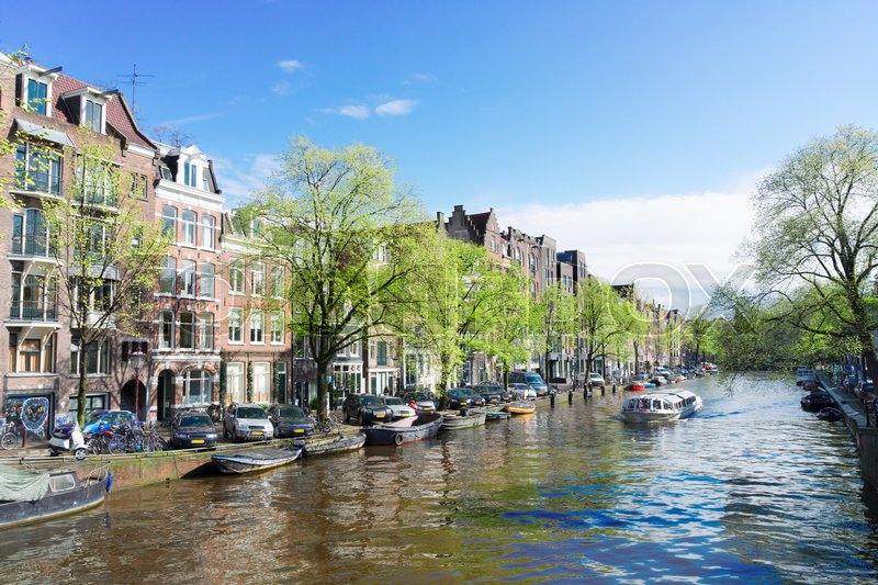Stock image of 'Facades of dutch houses over canal, Amstardam scenery, Netherlands'