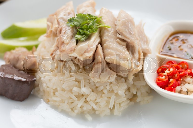 Stock image of 'Hainanese Chicken Rice with sauce'