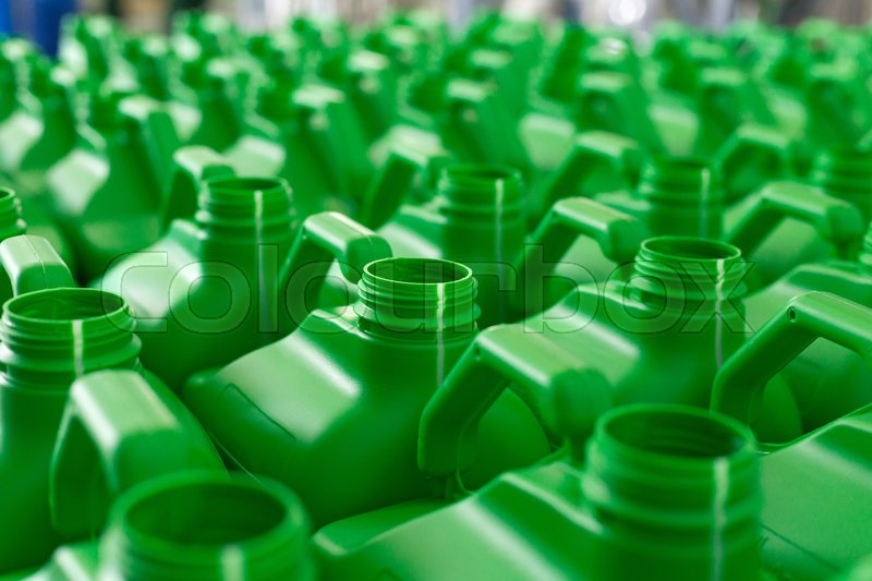 Stock image of 'Empty plastic cans green color for liquids. Concept: Manufacturing'