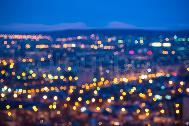 Stock image of 'Abstract circular bokeh city lights with horizon colorful background'