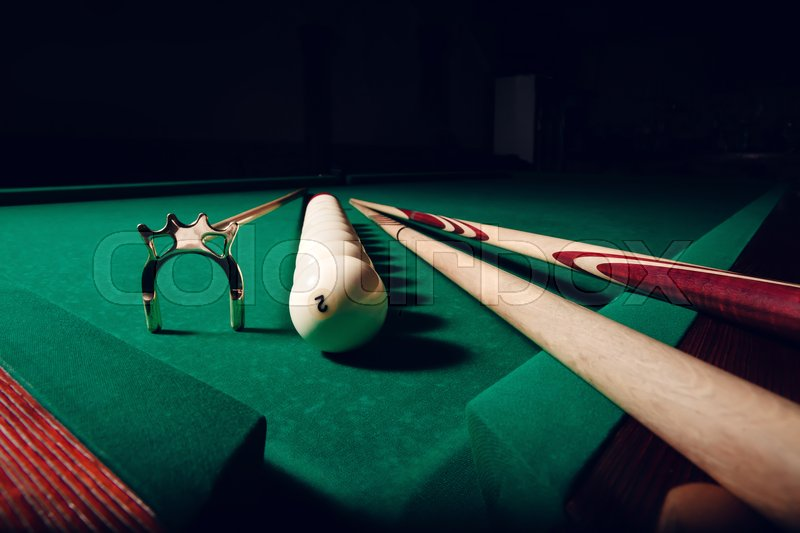 Stock image of 'Billiard equipment on the table, balls in the line'