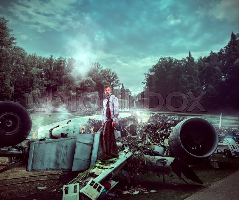 Stock image of 'Man after wreckage standing on the plane ruins'