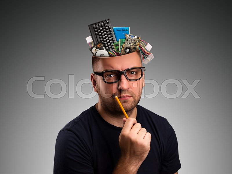 Stock image of 'Man with computer details in the head holding a pencil'