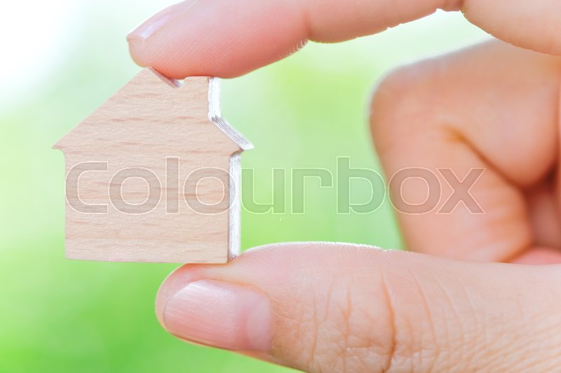 Stock image of 'hand holding icon house, concept image of make your house'