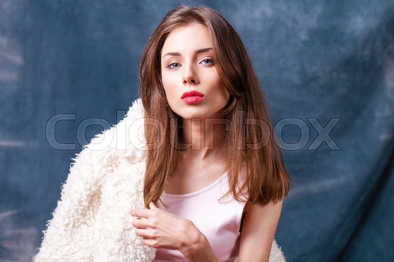 Stock image of 'Make Up. Beautiful young woman in dark studio'