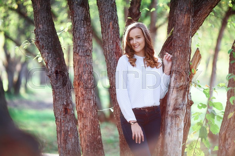 Stock image of 'Young cheerful beautiful woman. Beauty smiling teenager girl in autumn park'