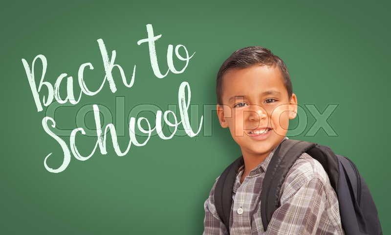 Stock image of 'Cute Hispanic Boy Wearing A Backpack In Front of  Chalk Board with Back To School Written On it.'