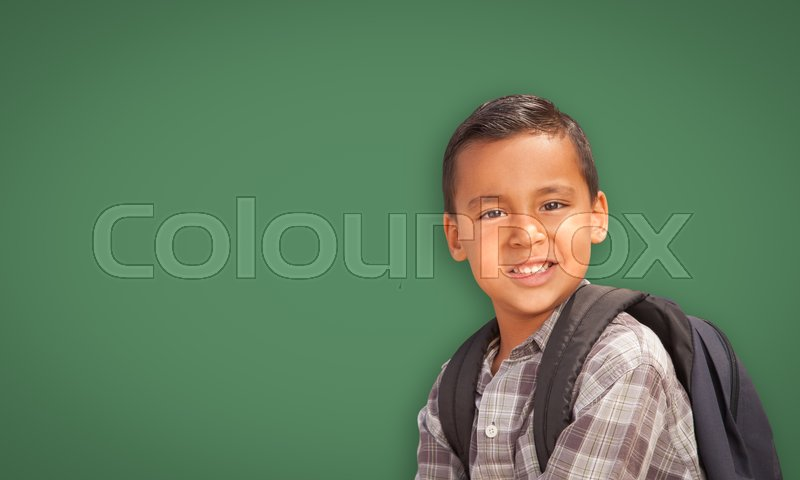 Stock image of 'Cute Hispanic Boy with Backpack In Front of Blank Chalk Board.'