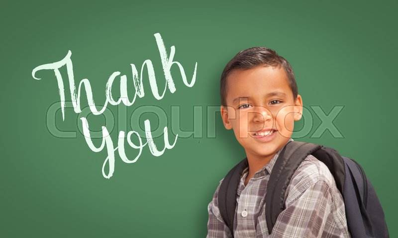 Stock image of 'Cute Hispanic Boy in Front of Chalk Board with Thank You Written On It.'