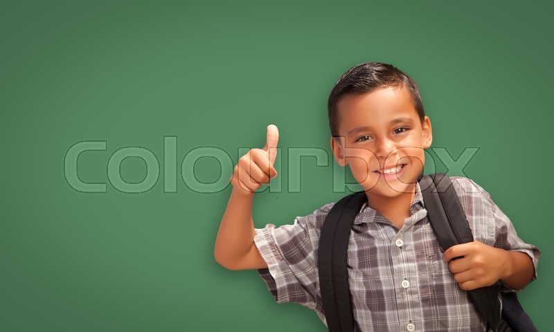 Stock image of 'Cute Hispanic Boy with Thumbs Up Wearing Backpack In Front of Blank Chalk Board.'