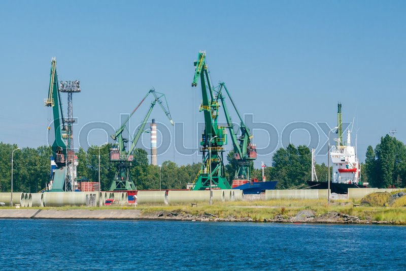 Stock image of 'Large cranes on a pier in the seaport of Gdansk.'