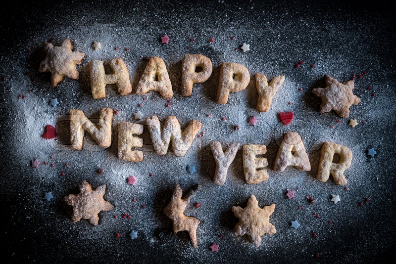 Stock image of 'Happy New Year cookies on the dark background '