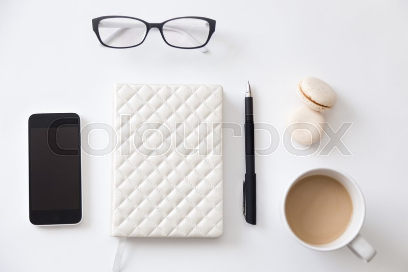 Stock image of 'Top view of a working desk with notebook, glasses, coffee. Education concept photo, close up, copy space'