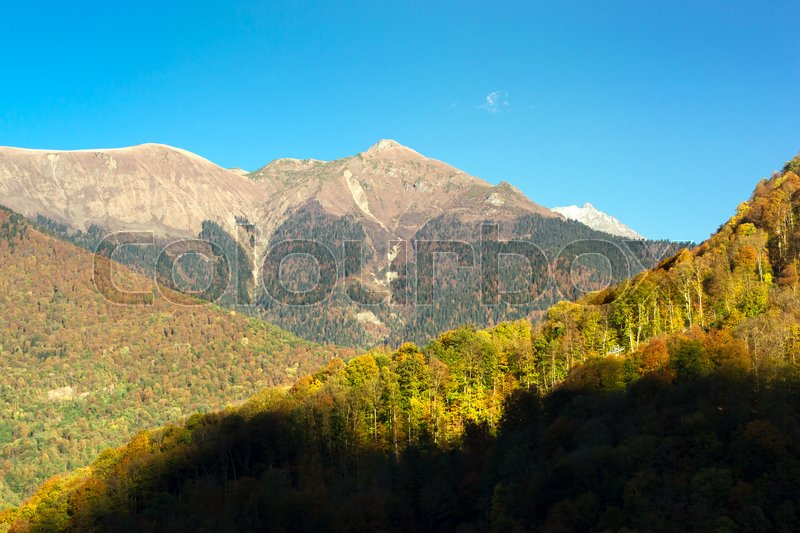 Stock image of 'Autumn mountain landscape, views of hills and peaks of Caucasus mountains. Krasnaya Polyana - Alpine ski resort, constructed from 2003 to 2011 for Sochi games. Rosa Khutor, Sochi, Russia'