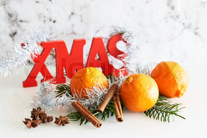 Stock image of 'mandarin, clementine, silver tinsel'