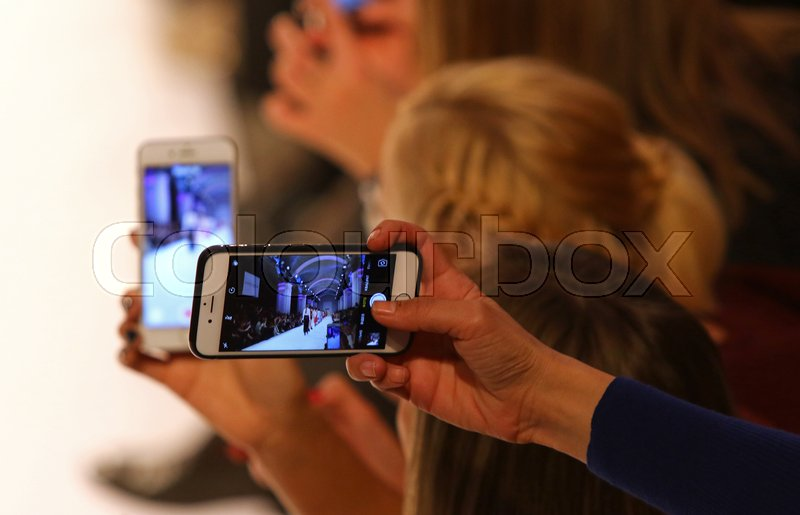 Editorial image of 'KYIV, UKRAINE - OCTOBER 15, 2016: People takes a picture of models on the catwalk during Fashion Show by Elena BURBA as part of 39th Ukrainian Fashion Week at Mystetskyi Arsenal in Kyiv, Ukraine'