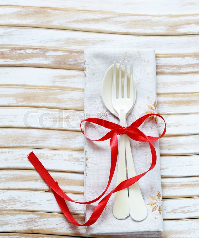 Stock image of 'Cutlery fork and spoon on a wooden background'