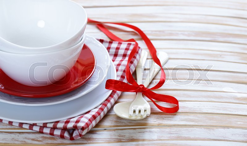 Stock image of 'Clean empty dishes cups and plates on wooden background'