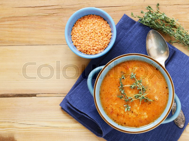 Stock image of 'Homemade tasty red lentil soup with thyme'