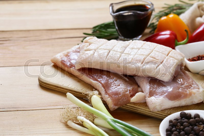Stock image of 'Raw duck fillet, spices and sauces for cooking'