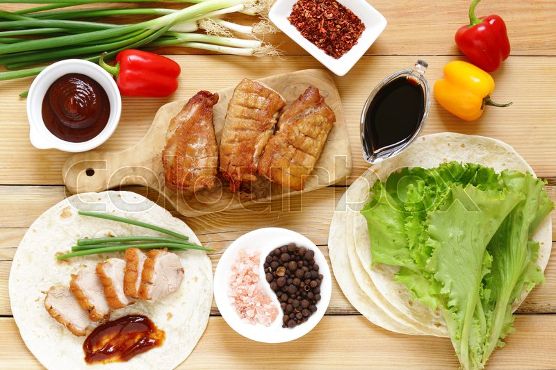 Stock image of 'Roasted duck breast served with in the Chinese style, Peking duck'