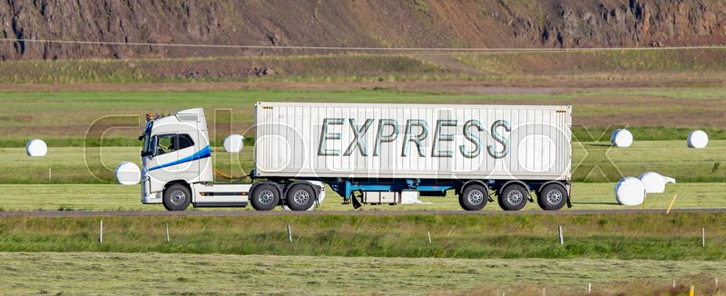 Stock image of 'White trruck driving through a rural area - Express'