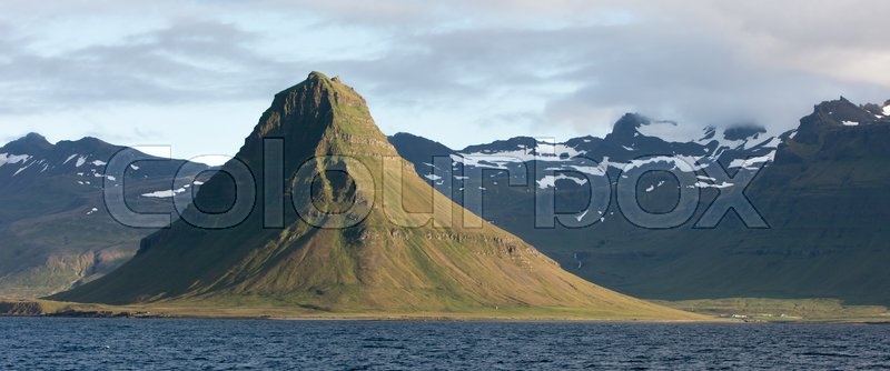 Stock image of 'Kirkjufell, Snaefellsnes peninsula - View from the water, sunset'