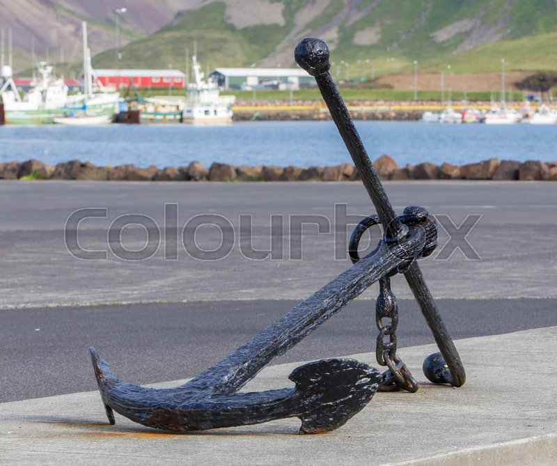 Stock image of 'Old anchor on the sea coast, large heavy anchor'