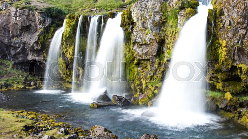 Stock image of 'Kirkjufellsfoss waterfall near the Kirkjufell mountain on the north coast of Iceland's Snaefellsnes peninsula'
