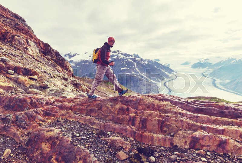 Stock image of 'Hiking man in Canadian mountains. Hike is the popular recreation activity in North America. There are a lot of picturesque trails.'