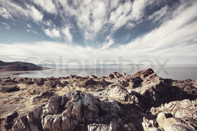 Stock image of 'Scenic view of the Great Salt Lake landscape on a sunny day with white clouds on a blue sky.'