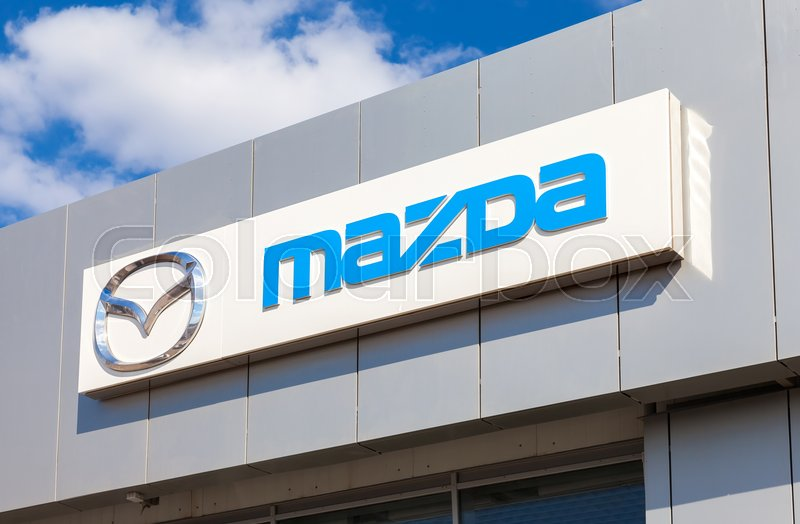 Editorial image of 'SAMARA, RUSSIA - MAY 11, 2016: Mazda logo on the facade of official dealer office. Mazda Motor Corporation is a Japanese car brand, automotive manufacturer'